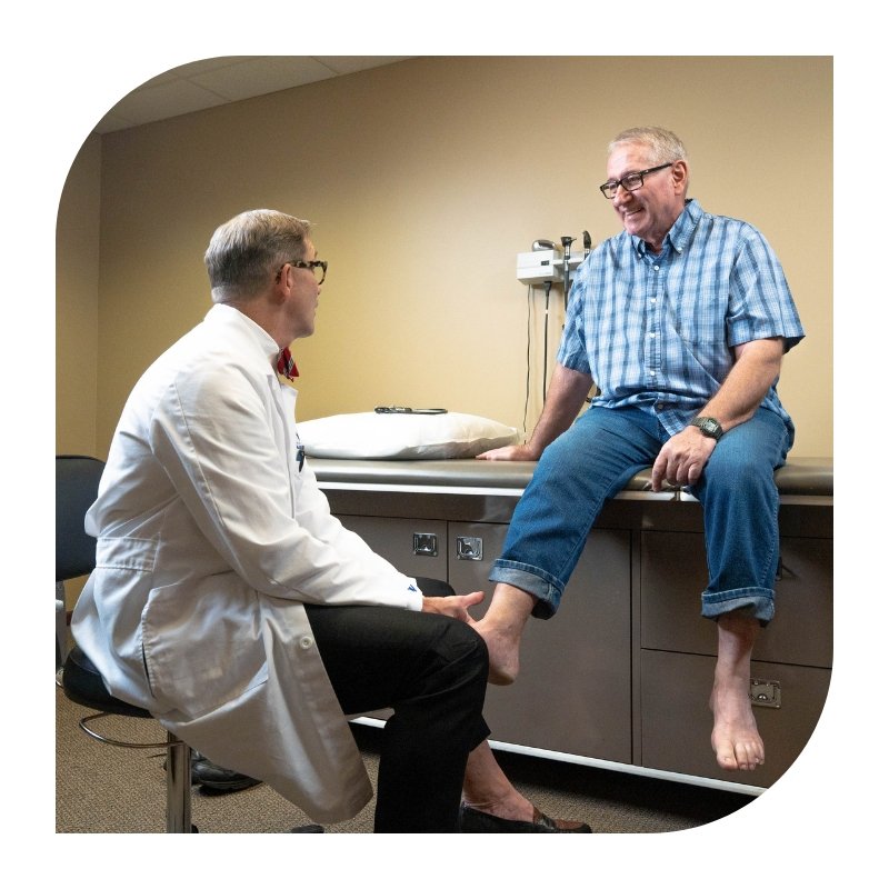 podiatrist meeting with patient examining foot